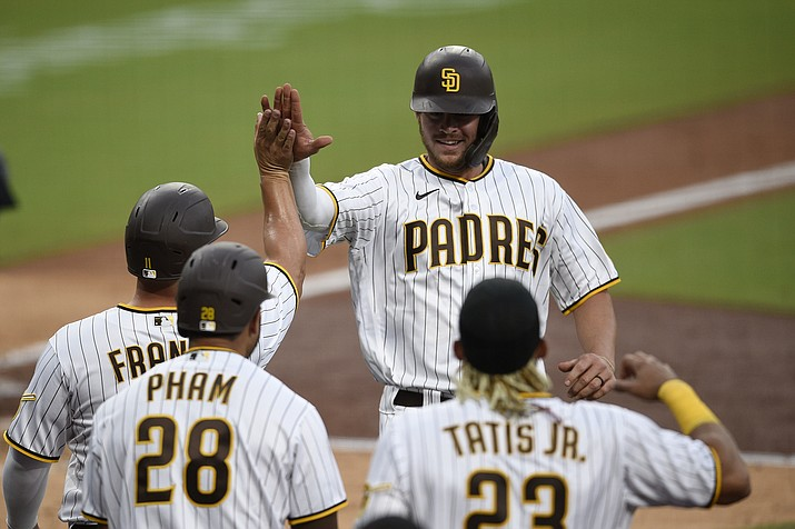 San Diego Padres designated hitter Wil Myers, top right, celebrates with Ty France after hitting a three-run home run during the fourth inning of a baseball game against the Arizona Diamondbacks in San Diego, Saturday, July 25, 2020. (Kelvin Kuo/AP)