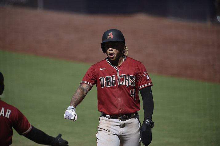 Arizona Diamondbacks' Ketel Marte is congratulated after scoring a run during the eighth inning of the team's baseball game against the San Diego Padres in San Diego, Sunday, July 26, 2020. The Diamondbacks won 4-3. (Kelvin Kuo/AP)