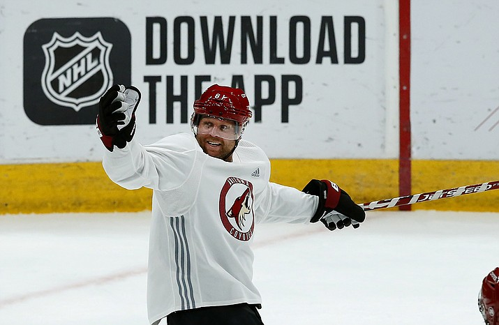 Arizona Coyotes right wing Phil Kessel celebrates a goal during NHL hockey practice at Gila River Arena, Monday, July 13, 2020, in Glendale, Ariz. (Ross D. Franklin/AP)
