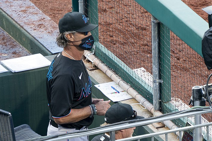 Miami Marlins' manager Don Mattingly looks out from the dugout during the eighth inning of a baseball game against the Philadelphia Phillies, Saturday, July 25, 2020, in Philadelphia. (Chris Szagola/AP)