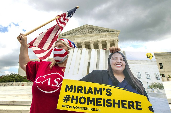 Ivania Castillo from Prince William County, Virgina, holds a banner to show her support for dreamer Miriam from California, as she joins Deferred Action for Childhood Arrivals (DACA) recipients in celebration in front of the U.S. Supreme Court after the Supreme Court rejected President Donald Trump's bid to end legal protections for young immigrants, June 18 in Washington. (AP Photo/Manuel Balce Ceneta)