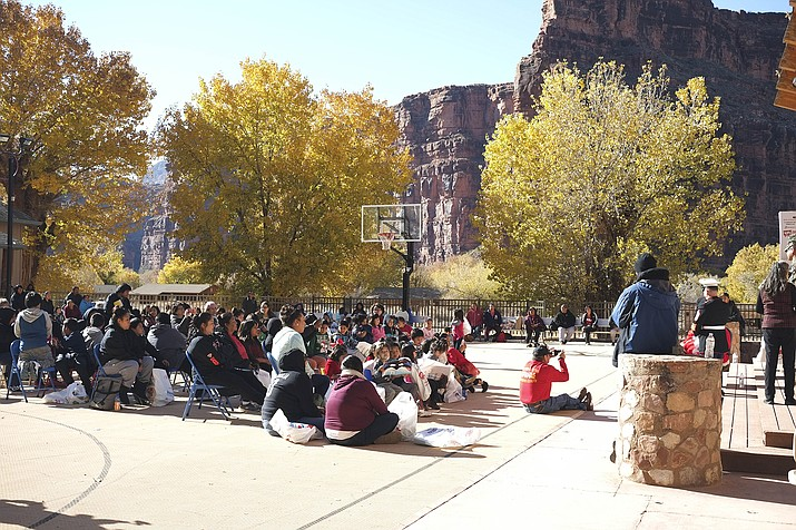 School children wait for a visit with Santa Claus in 2018 at Supai Village, located at the bottom of the Grand Canyon. (Loretta McKenney/WGCN)