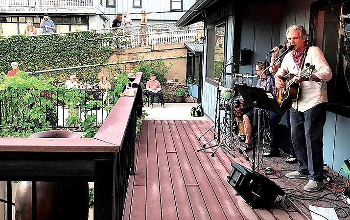 Singers John Ziegler and Candace Gallagher, guitarist Nick Michaels and percussionist Tory Campbell took the porch in Jerome last Thursday. Photo by Sherry Hopkins