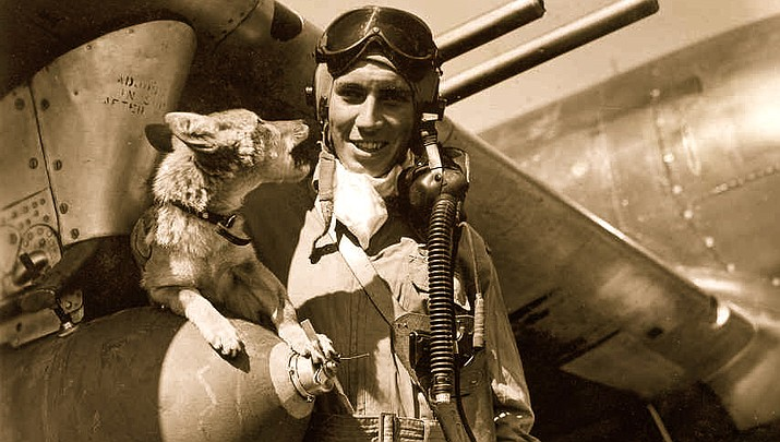 "John ""Wild Bill"" Crump and his pet coyote, Jeep, pose for a photo beside Crump's P-47 fighter plane at an airbase in England during World War II. (Courtesy photo)"