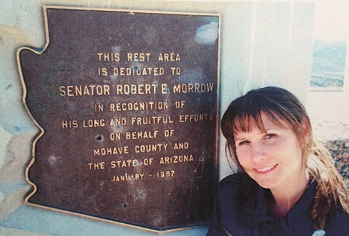 Robin Morrow Foster poses beside a plaque dedicated to her grandfather, former state senator and representative Robert E. Morrow of Kingman. Foster has published her grandfather's memoirs from World War I. (Courtesy photo)