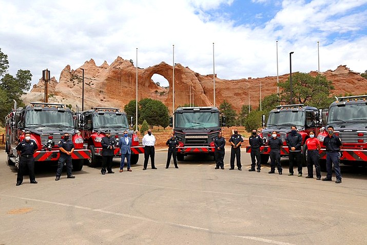 Navajo Nation Firefighters stand next to seven new fire trucks. Fire trucks will be assigned to fire stations in Shiprock, Window Rock, Amarillo, Ojo Encino, Newcomb, Chinle and Tuba City. Below: Council Delegate Amber Kanazbah Crotty thanks the fire deptartment for their service. (Photos/Office of the Navajo Nation Speaker's Office)
