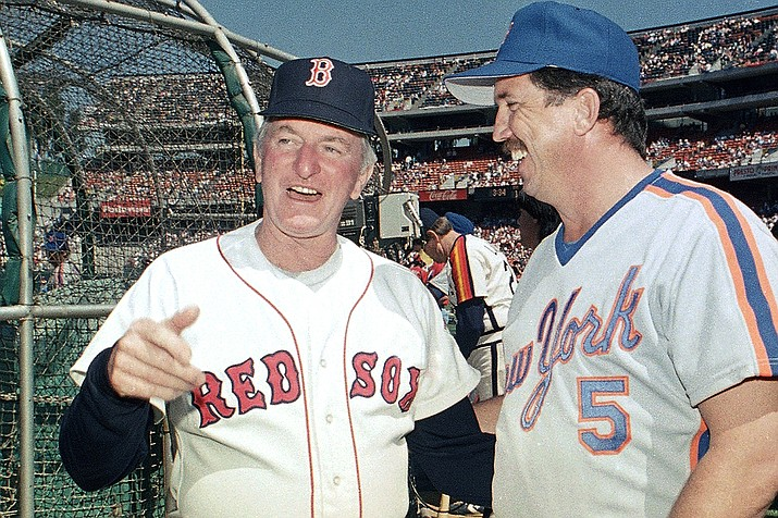 In this July 13, 1987, file photo, American League All-Star manager John McNamara, left, of the Boston Red Sox, chats with National League counterpart Davey Johnson, of the New York Mets, between workouts in preparation for the upcoming All-Star Game in in Oakland, Calif. McNamara, who managed several Major League Baseball teams during his career, died Tuesday, July 28, 2020, in Tennessee. He was 88. (Paul Sakuma, AP File)