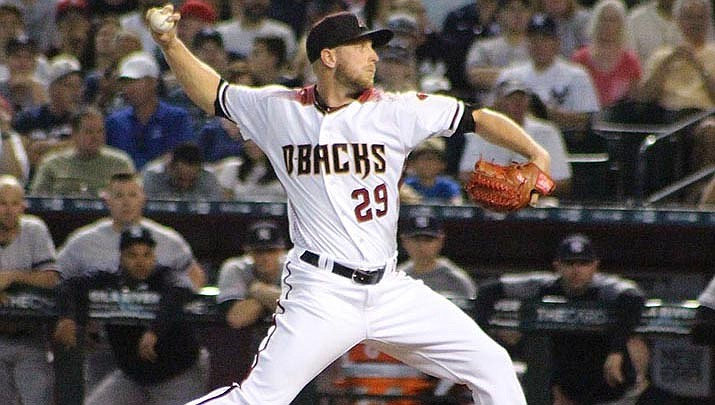 Arizona starting pitcher Merrill Kelly lost his no-hit bid in the seventh inning, but the Diamondbacks held on to beat the Texas Rangers 4-1 on Tuesday, July 28 at Arlington, Texas. (Photo by Barry Stahl, cc-by-sa-2.0, https://bit.ly/2EnCo6e)