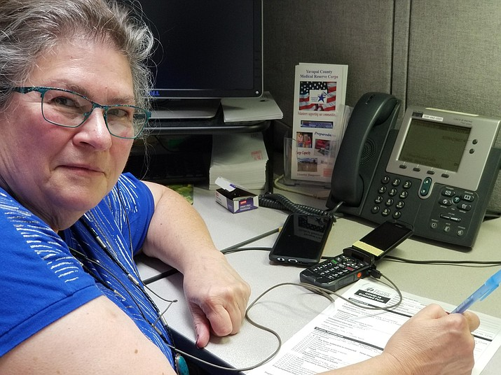 Yavapai County Community Health Services contact tracer Jo Ann French, a registered nurse for almost 50 years, sits at her desk where on a daily basis she makes 10 to 12 calls to those with positive results to try and thwart further spread. (Jo Ann French/Courtesy)