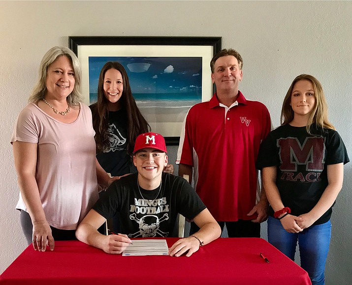 Mingus Union Class of 2020 graduate Peter Calandra, center, signs a letter of intent to play baseball at Atlantic Cape Community College in New Jersey. Pictured with Peter are, from left, Juli Nearing (mom), Heather (sister), Zack (dad), and Hope (sister). Courtesy photo