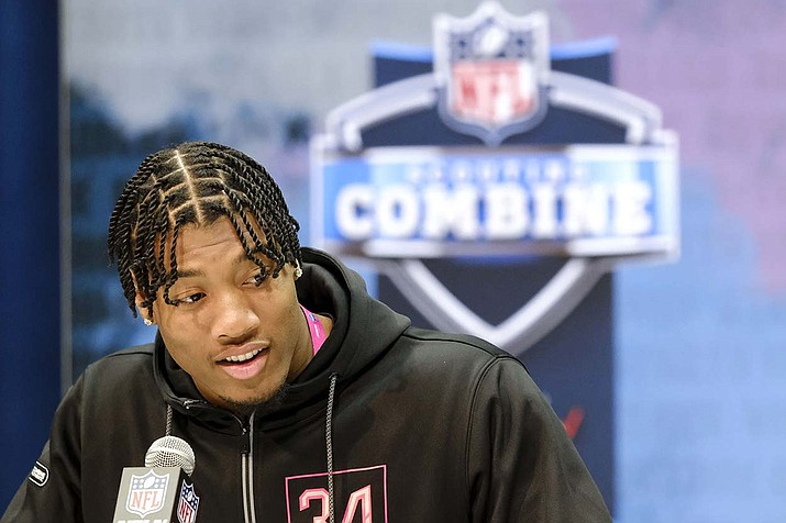 In this Feb. 27, 2020, file photo, Clemson linebacker Isaiah Simmons speaks during a press conference at the NFL football scouting combine in Indianapolis. Arizona Cardinals coach Kliff Kingsbury has raved about the Clemson star's versatility since he surprisingly landed in the desert after falling to the No. 8 overall selection. (AJ Mast, AP file)