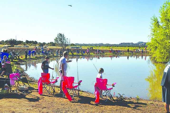 Young anglers and their helpers fish for channel catfish stocked at the Dunton Fort Rock Ranch for the Elks Lodge 468 Fishing for Smiles event in 2019. The 2020 edition is scheduled for Sept. 12. (File photo by Butch Meriwether/For the Miner)