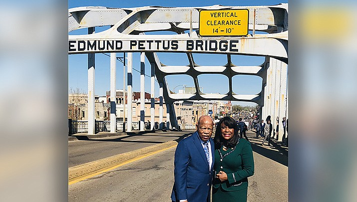 Members of Congress Rep. John Lewis  and Rep. Terri Sewell pose for a photo by the Edmund Pettis Bridge in Selma, Alabama, where Lewis was beaten by police during a Civil Rights march in 1965. (Rep. Terri Sewell office photo/Public domain)