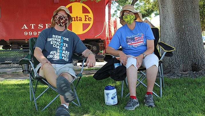 Scott and Camille Larson wear masks while attending a reopen the schools protest in Kingman this month. Kingman Mayor Jen Miles has extended her order requiring that face masks be worn in businesses until Sept. 1. (Photo by Agata Popeda/Kingman Miner)