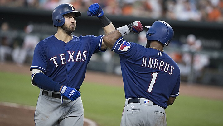 Joey Gallo of the Texas Rangers, left, smacked a two-run homer on Wednesday, July 29. It was the key blow in a five-run eighth inning as the Rangers rallied to beat Arizona 7-4. The Diamondbacks host the Los Angeles Dodgers in a four-game series this week. (Photo by Keith Allison, cc-by-sa-2.0, https://bit.ly/30ZH1eE)