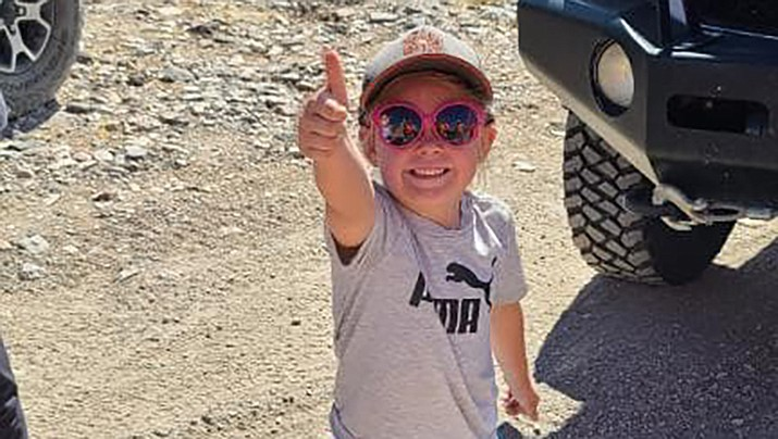 A 6-year-old girl gives the thumbs up to her rescuers after she and her party were rescued by Mohave County Sheriff's Office Search and Rescue in the Black Mountains on Sunday, July 26. (MCSO photo)
