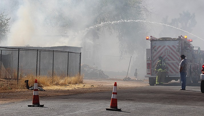 Kingman area firefighters battle a fire in the 3900 block of Northfield Avenue on Thursday, July 30. (Photo by Agata Popeda/Kingman Miner)