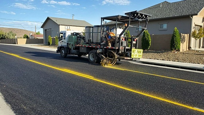 A stripe machine adds the finishing touches to Sunset Lane in Prescott Valley. (Courtesy)