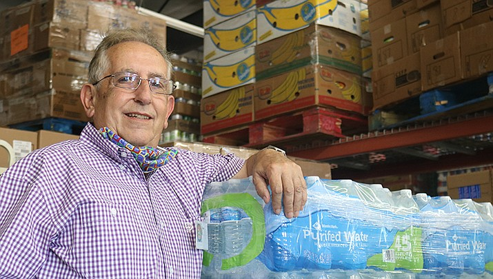 Mark McGregor poses for a photo at the Kingman Area Food Bank, where he accepted the executive director's position this summer. (Photo by Travis Rains/Kingman Miner)