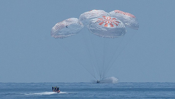 A SpaceX capsule carrying NASA astronauts Doug Hurley and Bob Behnken splashes down in the Gulf of Mexico off Pensacola, Florida, on Sunday, Aug. 2. It was the first splashdown by NASA astronauts since 1975. (NASA photo/Public domain)
