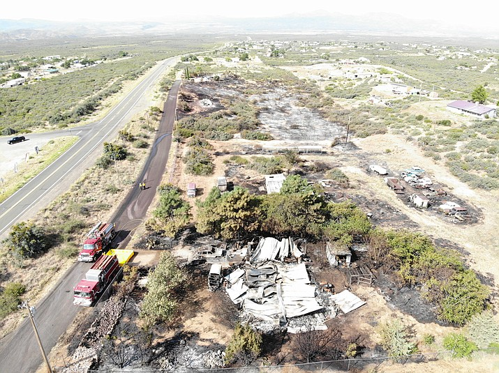 This drone shot shows the aftermath of a 5-acre fire in Wilhoit Sunday afternoon that destroyed three houses, two outbuildings and multiple cars. No serious injuries were reported. (YCSO/Courtesy)