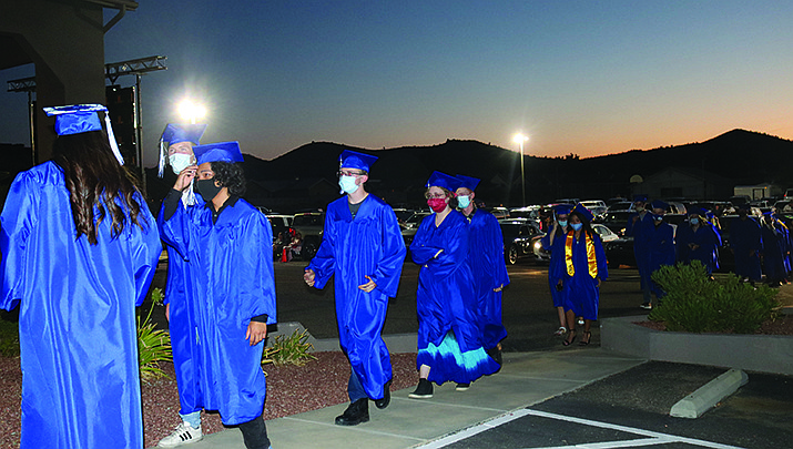Seniors from Kingman Academy of Learning High School finally walked across the stage on Saturday, Aug. 1, as graduation ceremonies were held after a nearly three-month delay due to the coronavirus pandemic. Friends and family watched on a large video screen from the parking lot at Hope City Church on Gates Avenue. (Photo by Travis Rains/Kingman Miner)