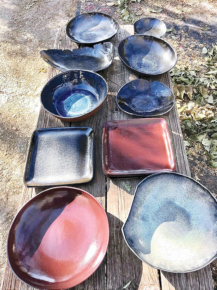 Alex Rovang uses a potter's wheel to form his more delicate pieces. He especially loves working with old earthen materials to form slabs using molds and large sheets of clay squeezed out while turning the large wheel.