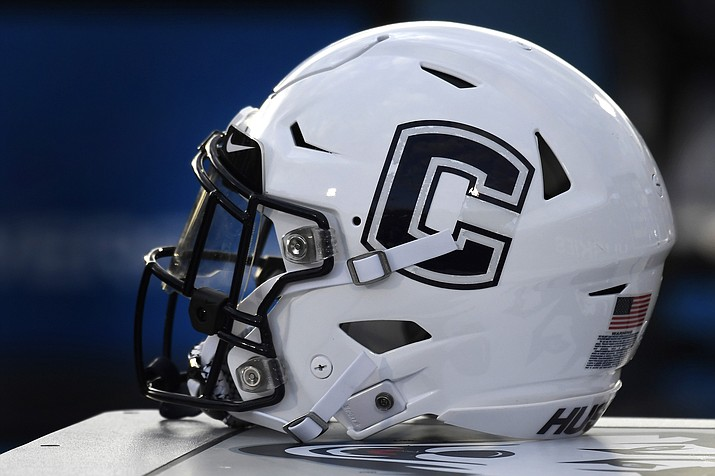 In this Sept. 7, 2019, file photo, Connecticut football helmet rests on the sideline during an NCAA college football game in East Hartford, Conn. UConn has canceled its 2020-2021 football season, becoming the first FBS program to suspend football because of the coronavirus pandemic. (Jessica Hill/AP, file)