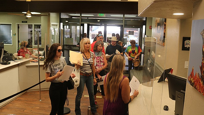 A group of about 10 people entered the Kingman City Complex on Thursday, Aug. 6 with a goal of providing information regarding mandatory face coverings, and their perceived danger, to elected officials. (Photo by Travis Rains/Kingman Miner)