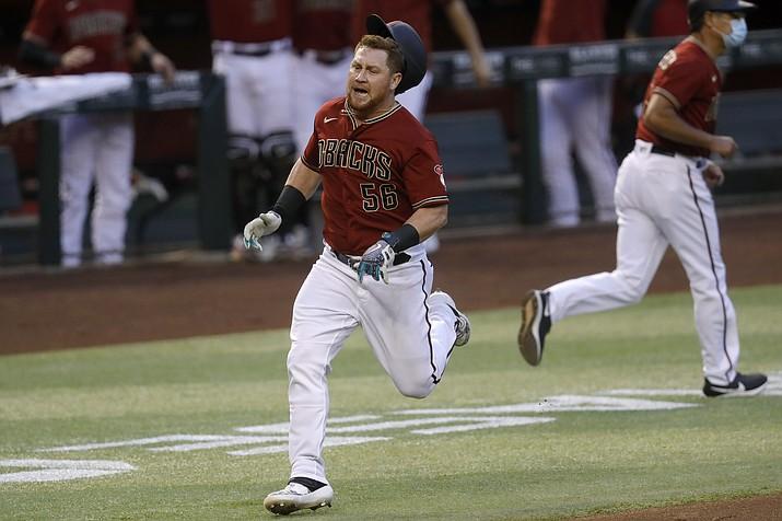 Arizona Diamondbacks' Kole Calhoun (56) rounds the bases after hitting an inside-the-park two-run home run during the fourth inning of a baseball game against the Houston Astros Wednesday, Aug. 5, 2020, in Phoenix. (Matt York/AP)