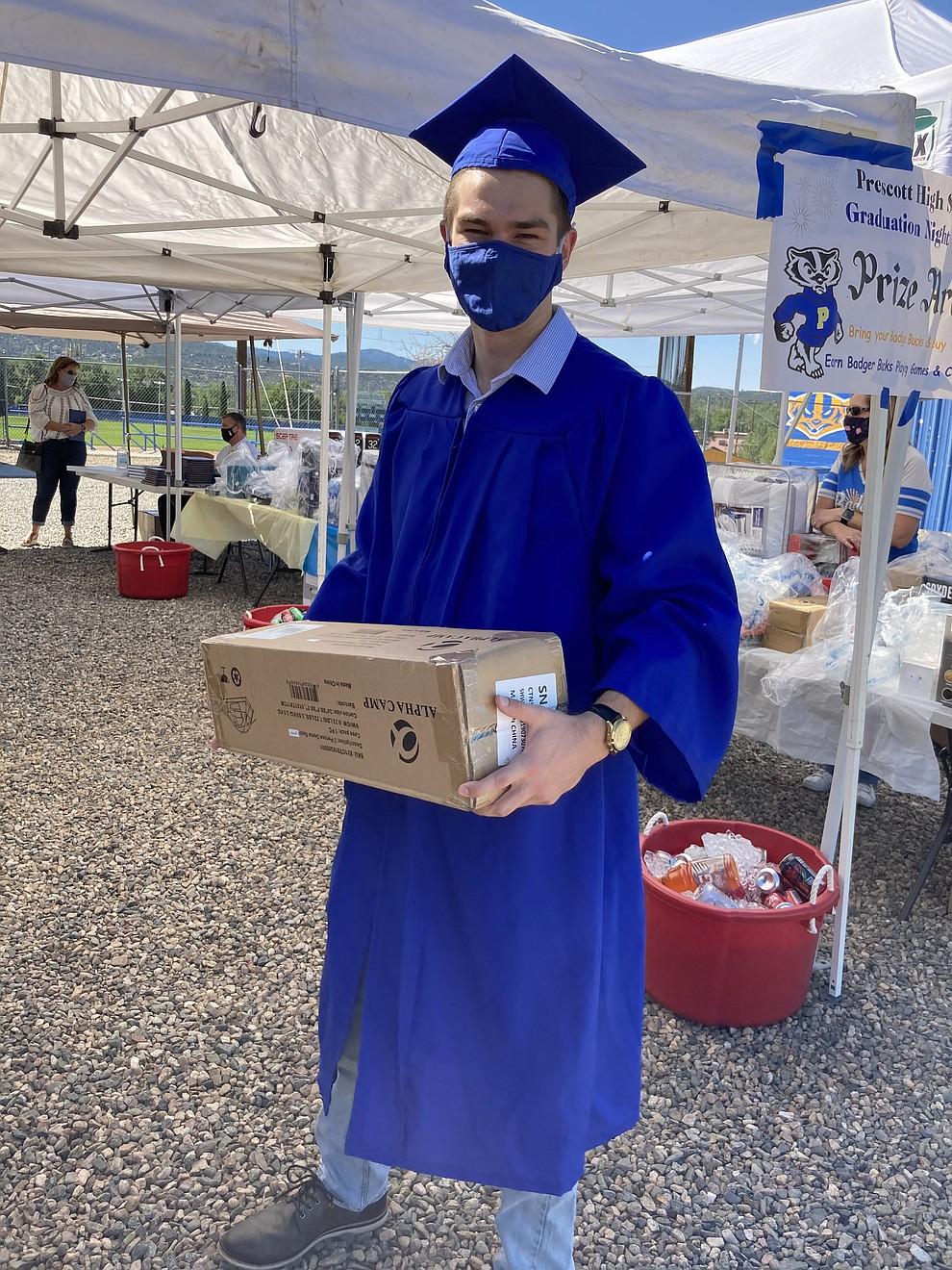Prescott High School graduate Lucas Forray picks up a Grad  Night gift at the school's graduation Saturday, Aug. 8, 2020. (Nanci Hutson/Courier)