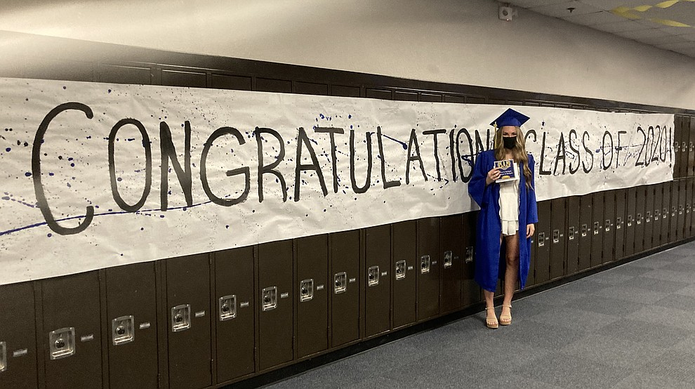 Prescott High School graduate Makenzie Ingallina poses in the school hallway at the Class of 2020 graduation Saturday, Aug. 8, 2020. (Nanci Hutson/Courier)