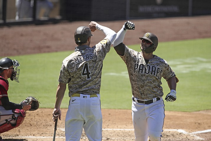 San Diego Padres Ty France, right, is congratulated by Wil Myers after hitting a solo home run Arizona Diamondbacks' in the third inning of a baseball game Sunday, Aug. 9, 2020, in San Diego. (AP Photo/Derrick Tuskan)