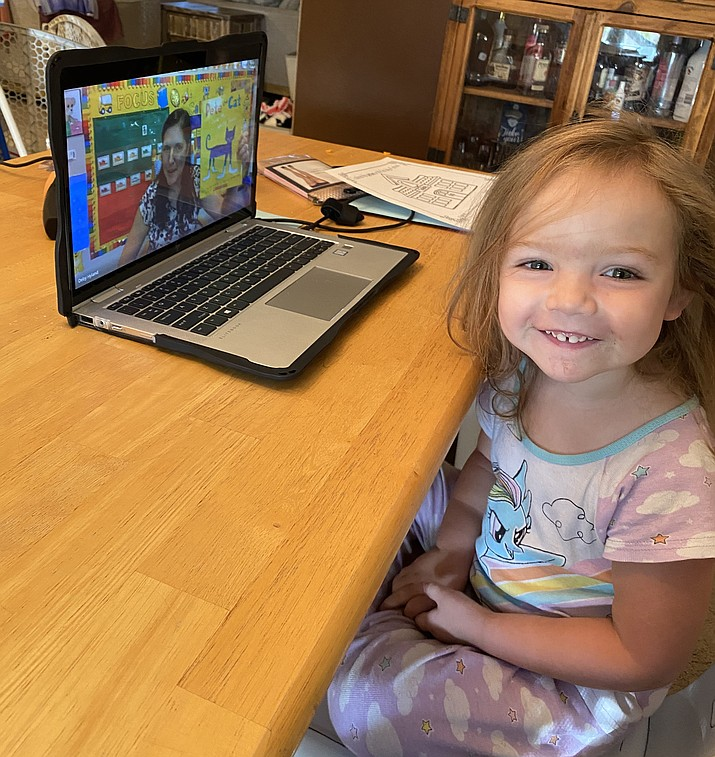 Three-year-old Haisley Holder, a student at Territorial Early Childhood Center in Chino Valley, sits in front of her laptop at home during the first day of school on Monday Aug. 10, 2020. Chino Valley Unified School District opted to open the school year with at-home, online-only instruction due to concerns surrounding the coronavirus pandemic. (Erika Holder/Courtesy)