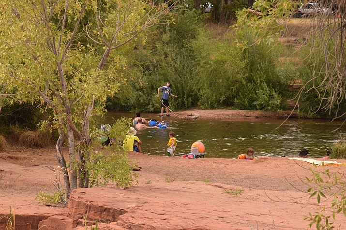 Dozens of swimmers were at Red Rock Crossing along Oak Creek on Sunday afternoon, five days after a sewage was dumped into the creek during a City of Sedona sewer construction project. VVN/Jason W. Brooks