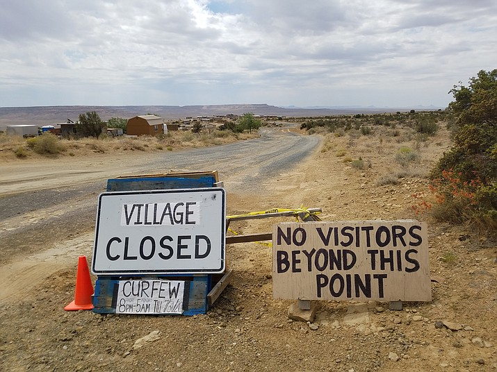 Warning signs at the entry to Oraibi Village. The Hopi villages remain locked down until March 31. (Photo/Red Feather Development Group)