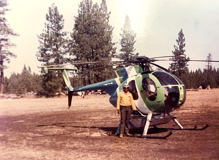 Edgar Brown stands in front of a Loach H-6 model 500 Helicopter in 1972. Brown spent most of his adult life working for the U.S. Forest Service. (Submitted photo)
