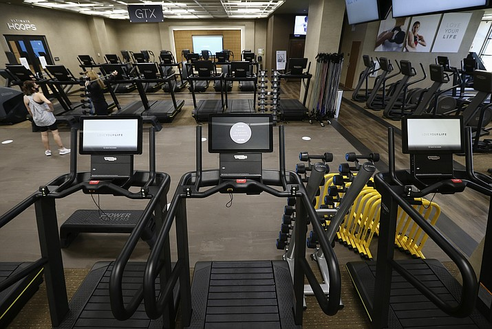 """Gym equipment is turned off at a Phoenix health club. Arizona Gov. Doug Ducey has issued an executive order for all gyms to close due to the surge in coronavirus cases, but he has agreed to provide a """"roadmap"""" to allow gyms, and other businesses, to reopen. (Ross D. Franklin/AP, file)"""