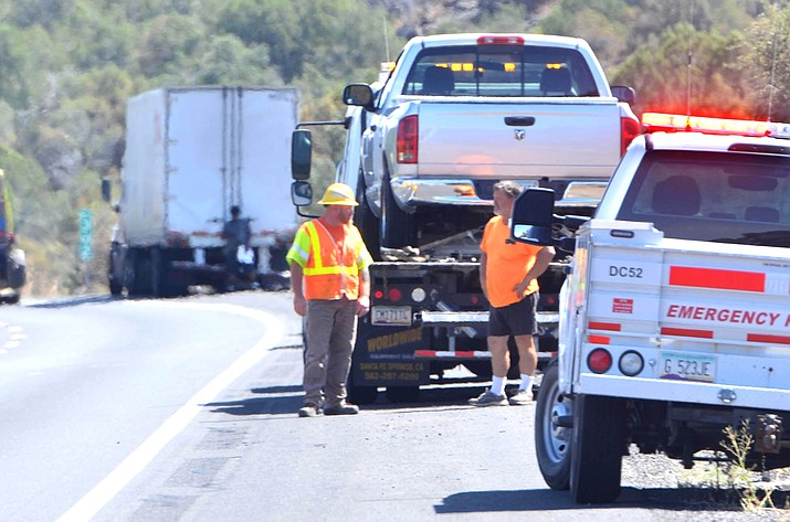 Three police vehicles, a tow truck and ADOT workers are on the scene at milepost 301 Tuesday afternoon where police said a motorist was stopped traveling the wrong-way the northbound lane. VVN/Vyto Starinskas