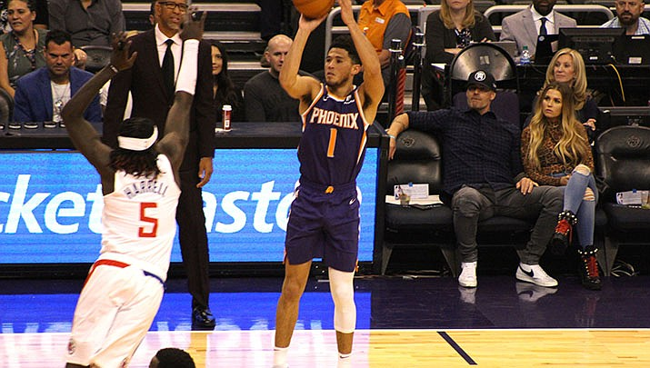 Devin Booker scored 35 points to lead the Phoenix Suns to a 130-117 win over the Philadelphia 76ers on Tuesday, Aug. 11 in Orlando. The Suns are 7-0 since the NBA reopened play, and remain in contention for the final playoff spot in the Western Conference. (Miner file photo)