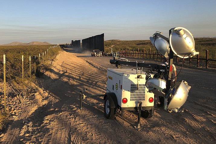 This January 2020 photo provided by the Center for Biological Diversity shows construction on a new border wall in the wetlands at the San Bernardino National Wildlife Refuge in southeastern Arizona. The federal agency in charge of the refuge warned for several months that pumping water to build a border wall would decimate the habitat, and correspondence obtained by two environmental groups shows that U.S. Customs and Border Protection ignored most of those warnings and pulled water from wells so close to the refuge that some of its ponds went dry. (Laiken Jordahl/Center for Biological Diversity via AP)