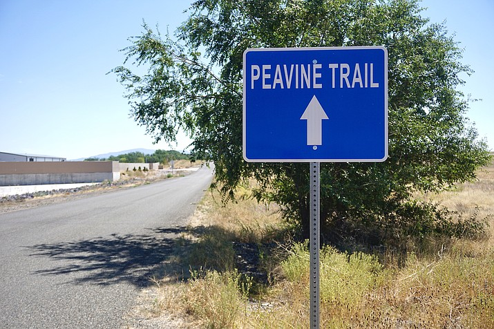 A sign on Road 4 South in Chino Valley points to the way of an access point for the Peavine Trail, which is being improved by the Yavapai Trails Association. (Aaron Valdez/Review)