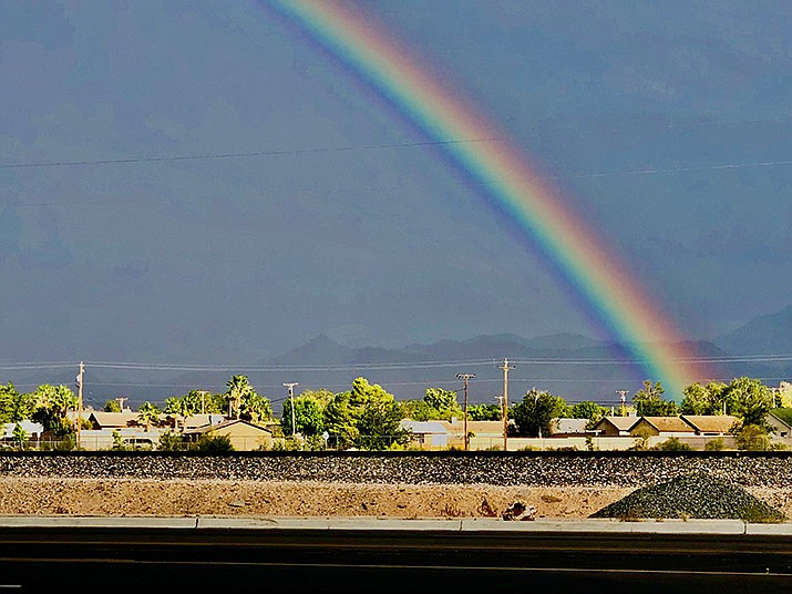 Kingman got a taste of rain on Sunday, Aug. 16 when the National Weather Service recorded .03 inches falling at Kingman Airport. There is a chance of rain daily through Wednesday, Aug. 19. A rainbow is shown over Kingman in this file photo. (Miner file photo)