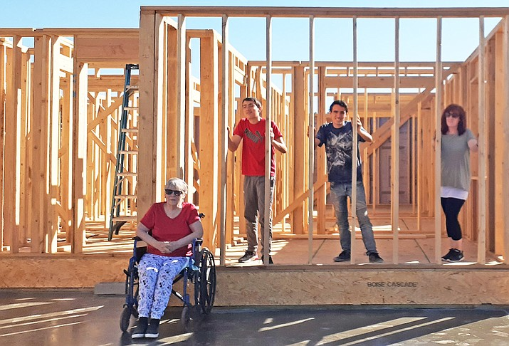 Volunteers from the Williams community help raise a wall at Habitat for Humanity's sixth home build in Williams Aug. 15. (Photos/Patty Wiliams)