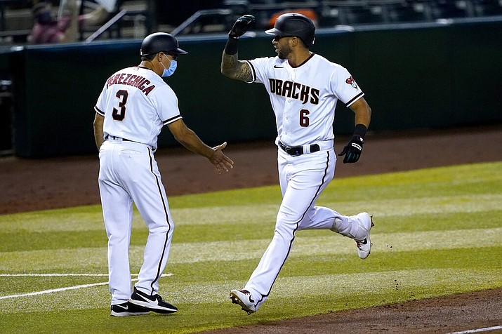Arizona Diamondbacks' David Peralta (6) rounds the bases after hitting a solo home run against the Oakland Athletics during the third inning of a baseball game Monday, Aug. 17, 2020, in Phoenix. (AP Photo/Matt York)