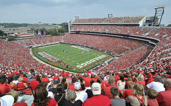 In this Sept. 5, 2015, file photo, Georgia fans watch the season opening NCAA college football game against Louisiana Monroe at Sanford Stadium n Athens, Ga. The Georgia Bulldog are planning to have fans between the hedges. The school announced ticket plans that call for allowing 20-25% capacity at 92,746-seat Sanford Stadium. (John Amis, AP File)