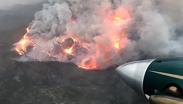 The Ridge Fire is shown burning in the Hualapai Mountains. The fire had burned 986 acres by noon on Wednesday, Aug. 19. (BLM photo/Public domain)