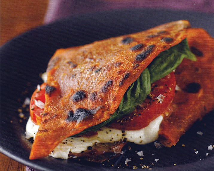 Piadina is a close cousin to traditional pizza that is made from unleavened dough. (Metro Creative)