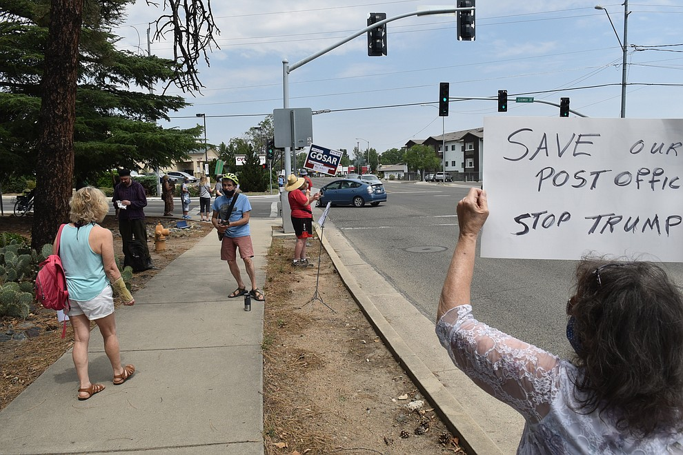 "A small group of around 20 protesters gather, some singing ""my baby must have wrote me a letter,"" and other songs about the mail, in front of the Post Office in Prescott, on Saturday, Aug. 22, 2020. (Jesse Bertel/Courier)"