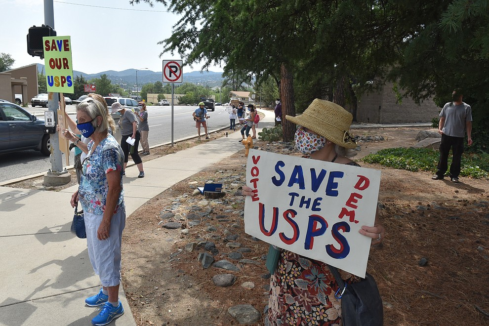 A small group of protesters gather in front of the Post Office in Prescott, on Saturday, Aug. 22, 2020. (Jesse Bertel/Courier).